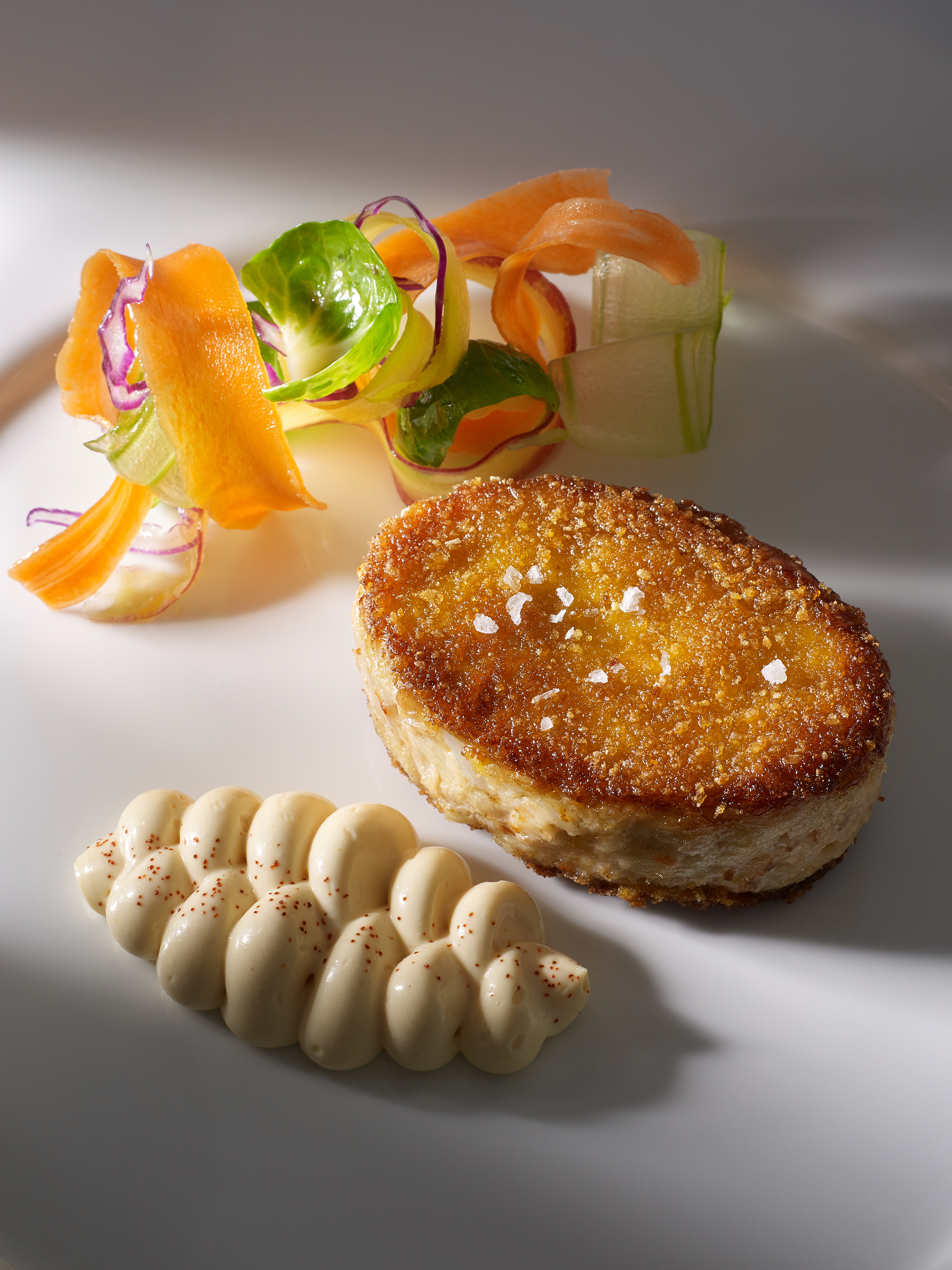 Crab cake on white plate