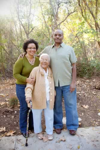 Man and wife with elderly parent