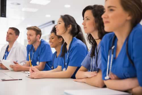 medical-students-listening-sitting-at-desk-at-the-university