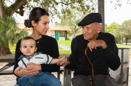 elderly-eighty-plus-year-old-man-with-granddaughter-in-a-outdoor-setting