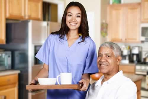 health-care-worker-helping-an-elderly-man