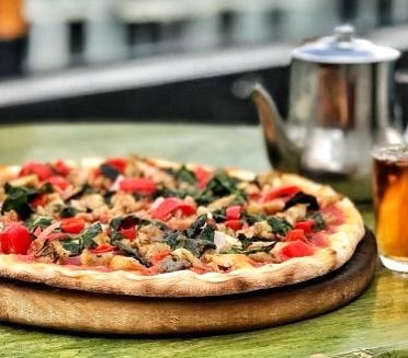 "Have u tried ""ዝ-ዋይ /zih-waay/"" 😁?! 🍕Our 100% locally sourced fasting pizza 🍕 It boasts... Herb braised ziway tilapia 🐟, spinach 🍃, sweet chilli peppers🌶️ red onions 🌰. Available at all our branches during Lent seasson. . . . #እፎይ #effoi #pizza #fastingpizza #seasonalpizza #localpizza #proudlyethiopian #delicious"