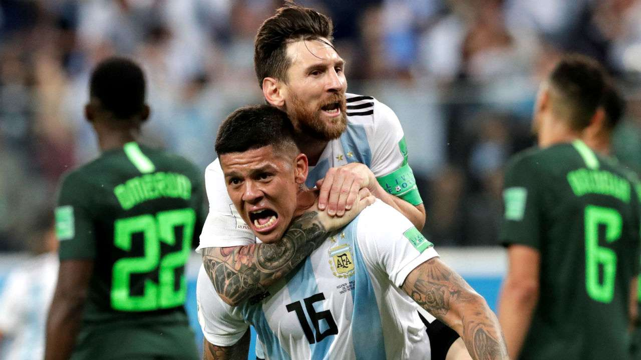 Marcos Rojo celebrates his game winning goal with captain Lionel Messi.