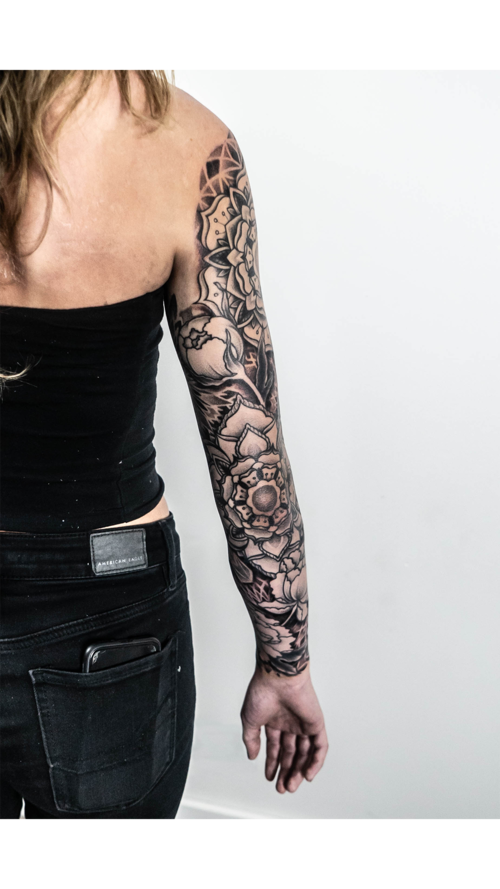 Black and Gray Arm Sleve by Jon Hanna at Certified Tattoo Studios.png