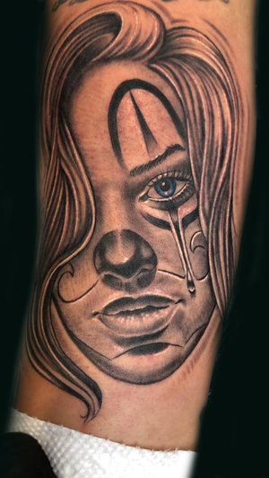 Custom Black and Gray Woman Clown  Tattoo by Ramon at Certified Tattoo Studios Denver Co.jpg