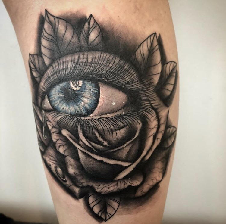 Custom Black and Grey Eye in a Rose  Tattoo by Darious at Certified Tattoo Studios Denver CO.jpg