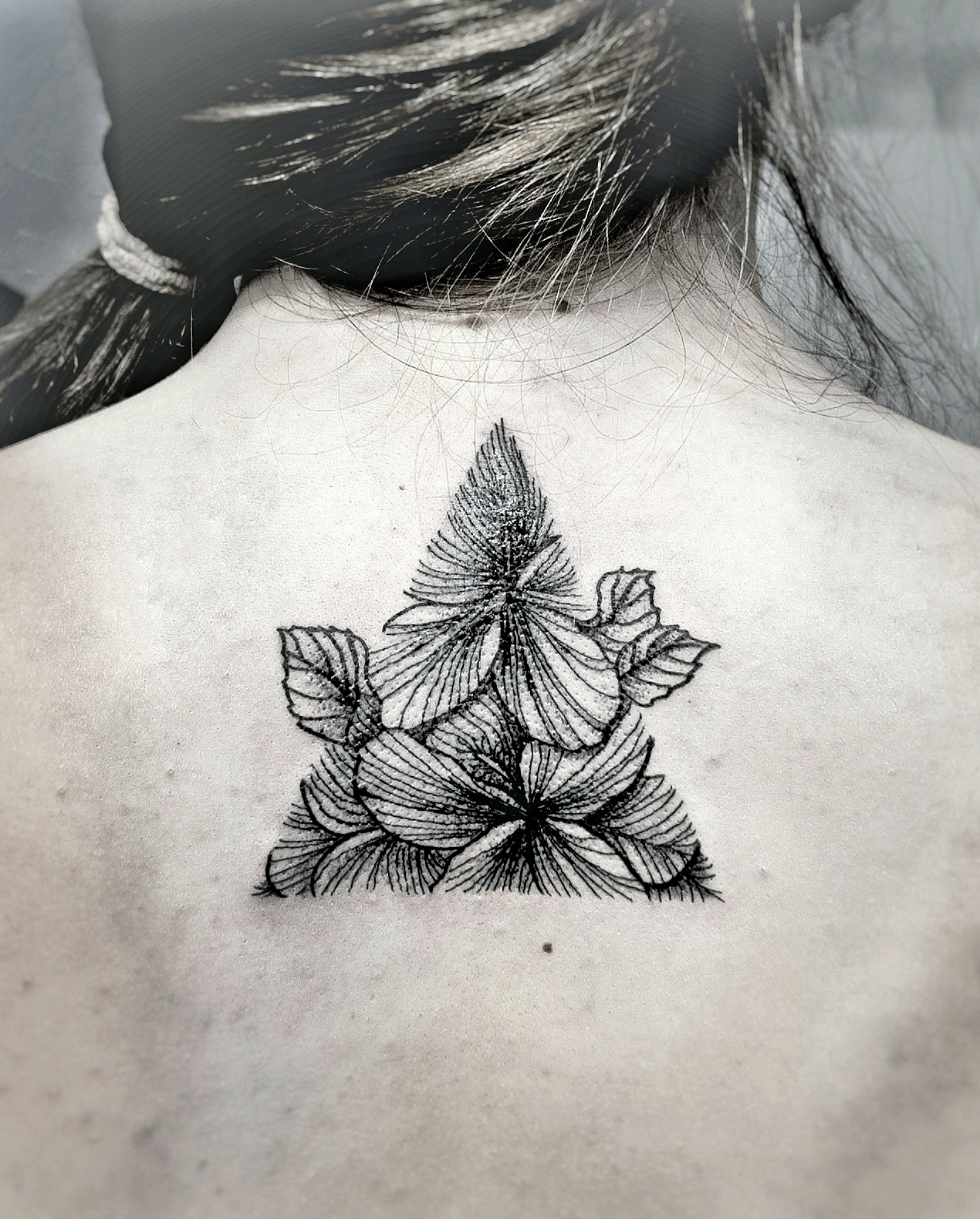 Custom Black Work Hibiscus Flowers inside a Trianlge Tattoo by Dani at Certified Tattoo Studios Denver Co.jpg