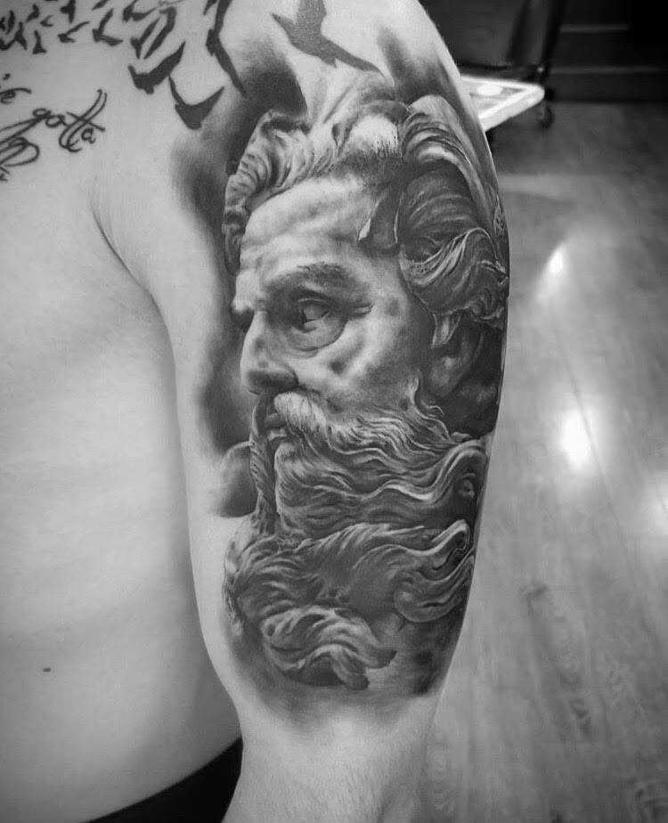 Custom Black and Grey Neptune Portait Tattoo by Alix at Certified Tattoo Studios Denver Co.jpg