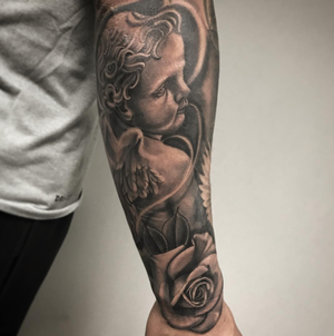 Custom Black and Grey Angel with a Rose Tattoo by Salvador Diaz at Certified Tattoo Studios in Denver Co (2).png