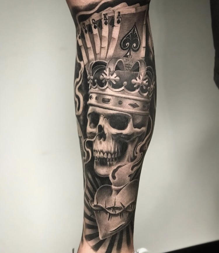 Custom Black and Grey Playing Cards and King Skull in Smoke Tattoo by Salvadro Diaz at Certified Tattoo Studios Denver Co.jpg