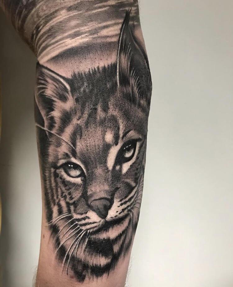 Custom Black and Grey Wild Feline Portrait Tattoo by Salvador Diaz at Certified Tattoo Studios Denver Co.jpg