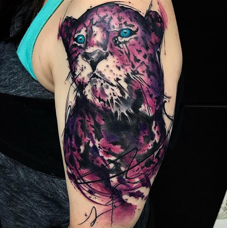 Custom Water Color Purple Sitting Leopard Tattoo by Skyler Espinoza at Certified Tattoo Studios Denver Co.jpg