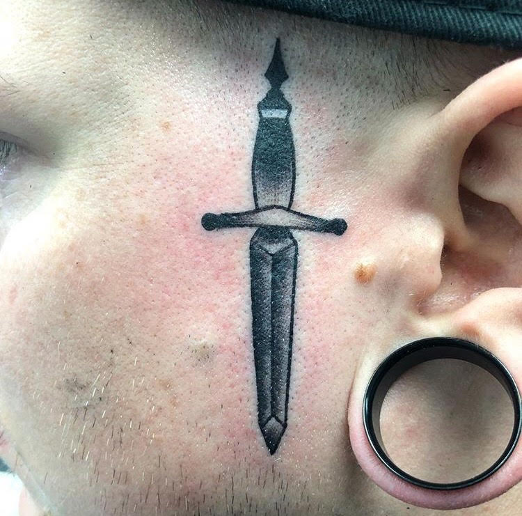 Custom Black and Grey Neo Traditional Dagger Face Tattoo by Alec Rowe at Certified Tattoo Studios Denver Co.jpg