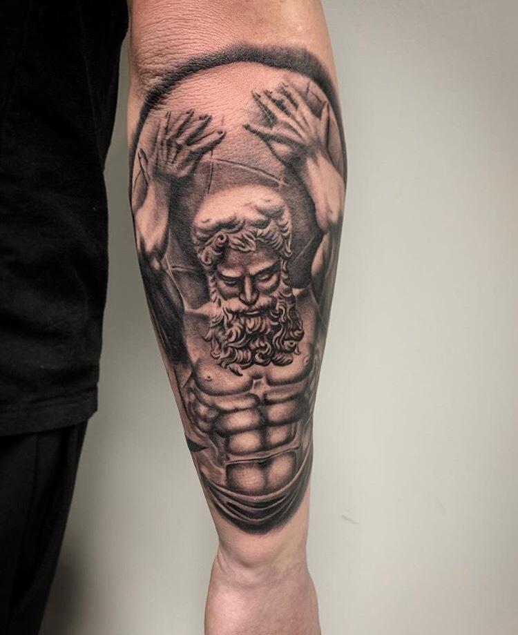 Custom Black and Grey Atlas Tattoo by Salvador Diaz  at Certified Tattoo Studios Denver CO.jpeg