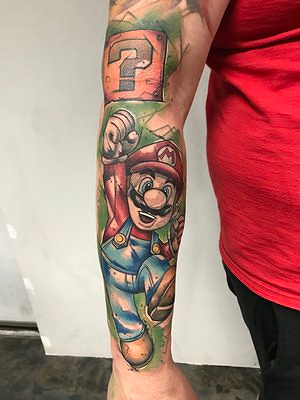 Water Color Mario Tattoo by Skyler Espinoza at Certified Tattoo Studios in Denver Co.jpg