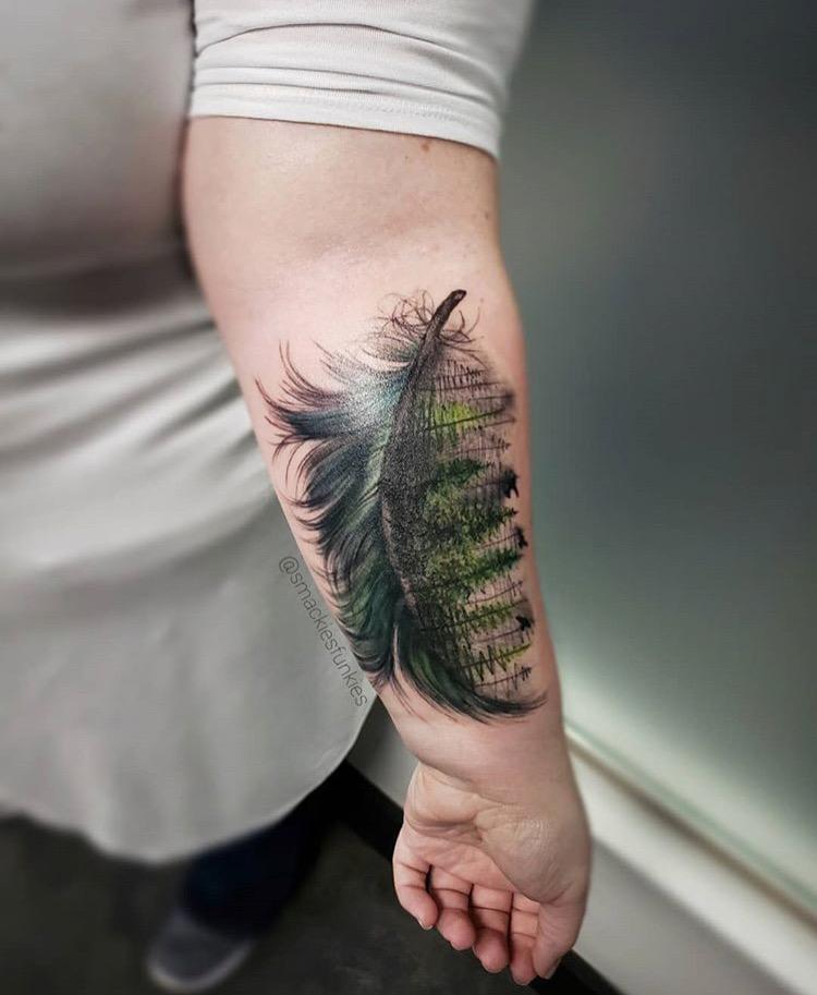 Custom Illustartive Green Feather transitionsing into Trees Tattoo by David Perea at Certified Tattoo Studios denver Co .JPG