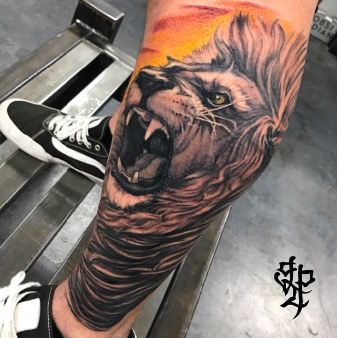 Custom Black and Grey Roaring Lion and Orange Sunset Tattoo by Greg Paquin at Certified Tattoo Studios Denver CO .jpg