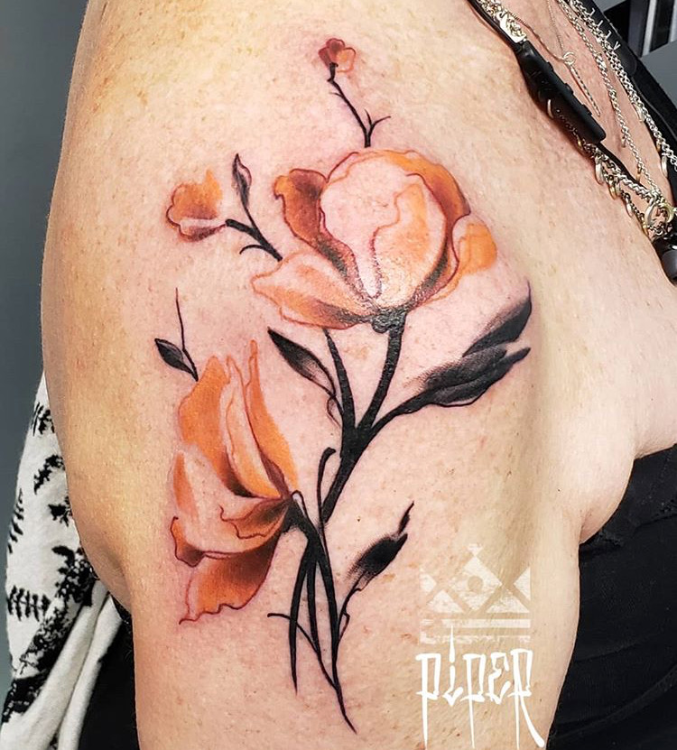 Custom water Color Orange Flower Tattoo by Mike Piper at Certified Tattoo Studios Denver Co .JPG