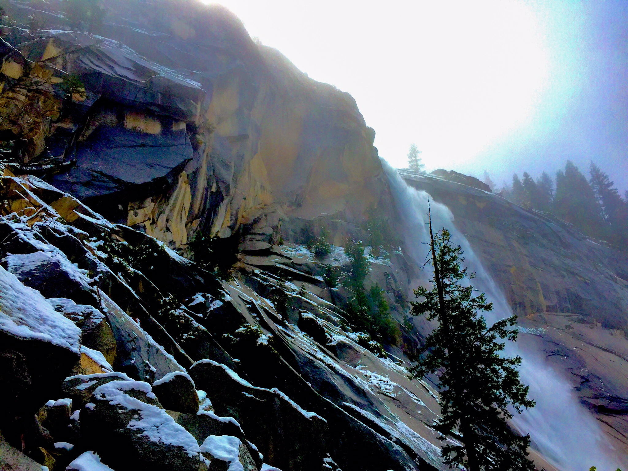 a rare view of nevada falls with snow