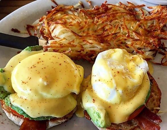 California Benedict. Crisp, thick bacon, avocado, sliced tomato, poached eggs and house made hollandaise.