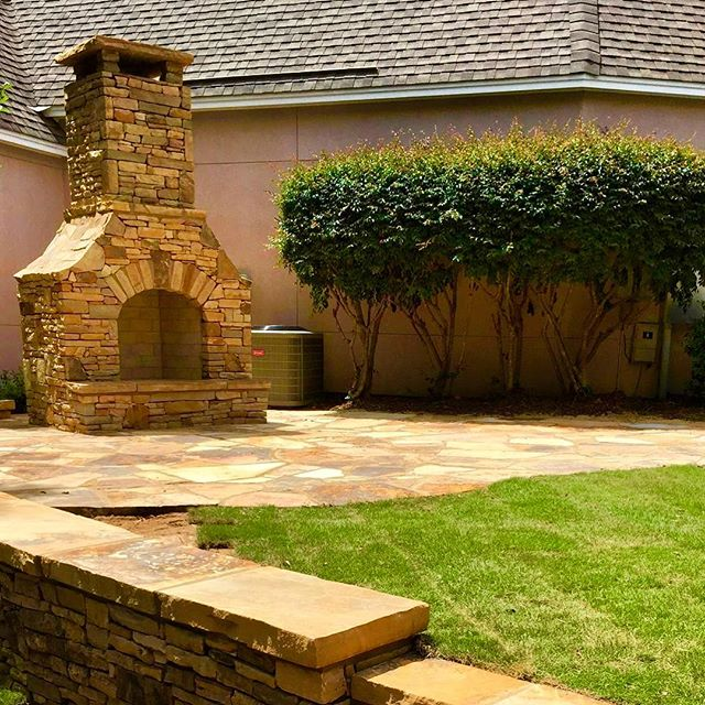 This hearth and patio is the perfect addition to any backyard. #outdoorfireplace #patiodesign