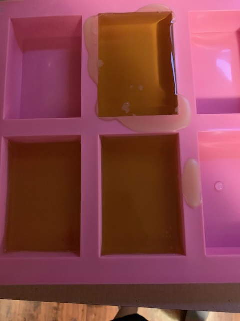 bars cooling in a pink silicone soap mold