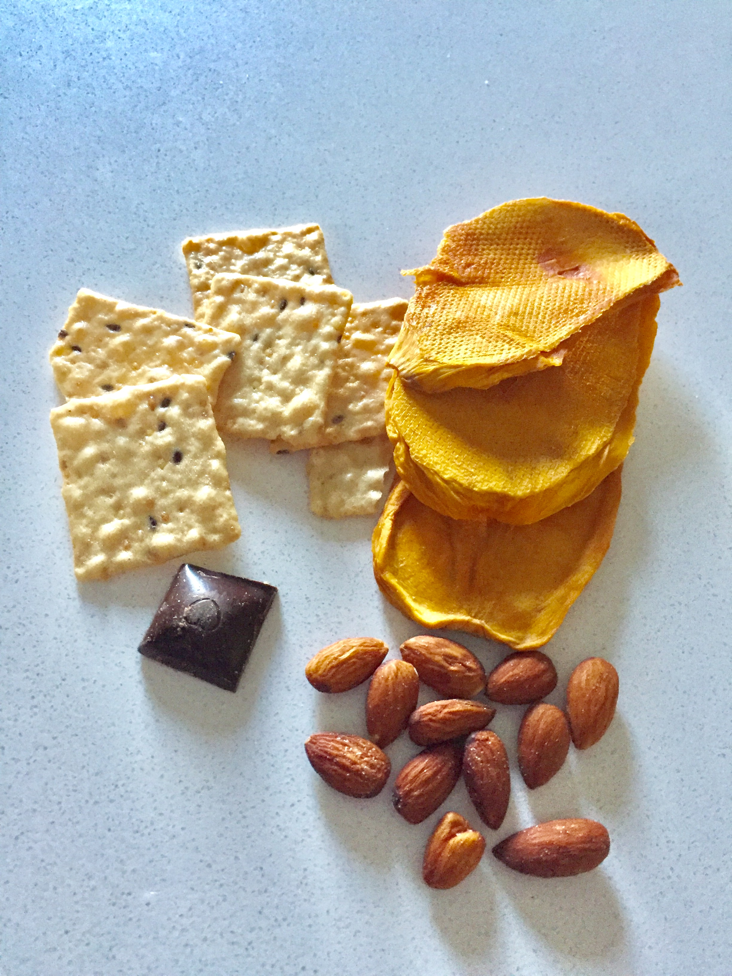 Snack: Rice crackers, dry mango, nuts, dark chocolate.