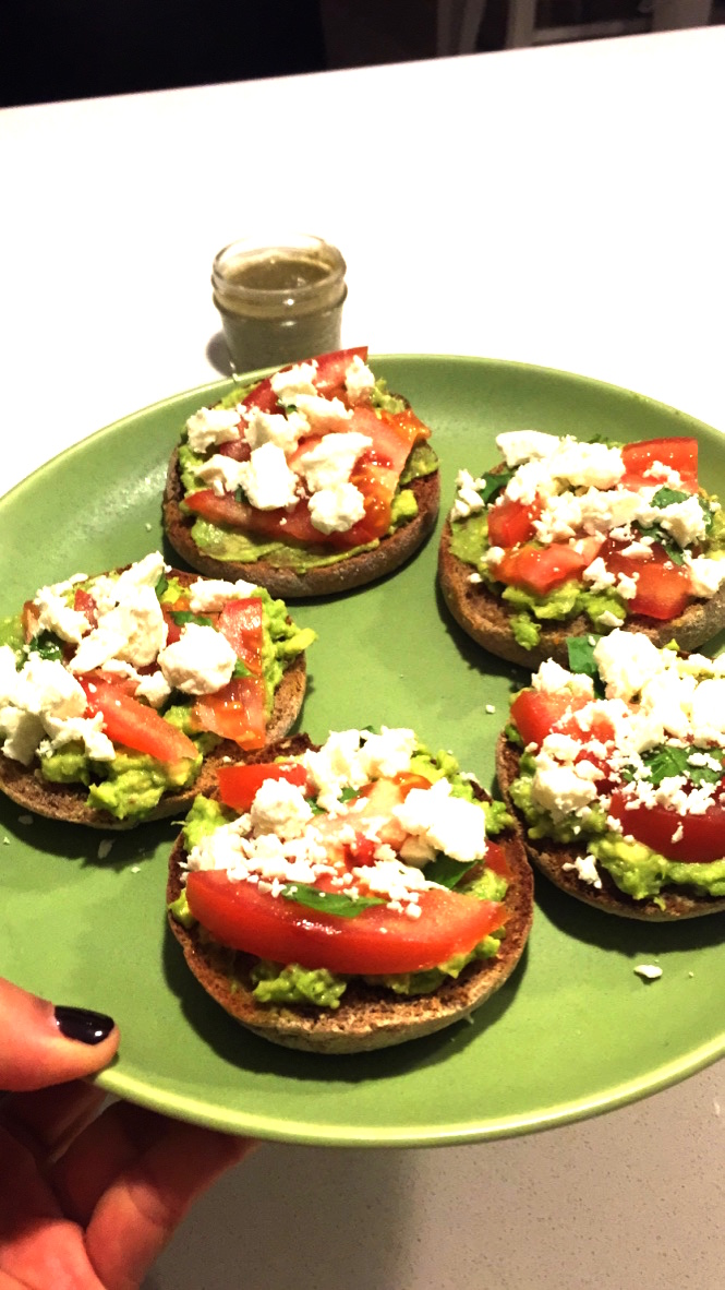 Whole wheat English muffins, avocado, tomatoes, and feta cheese.
