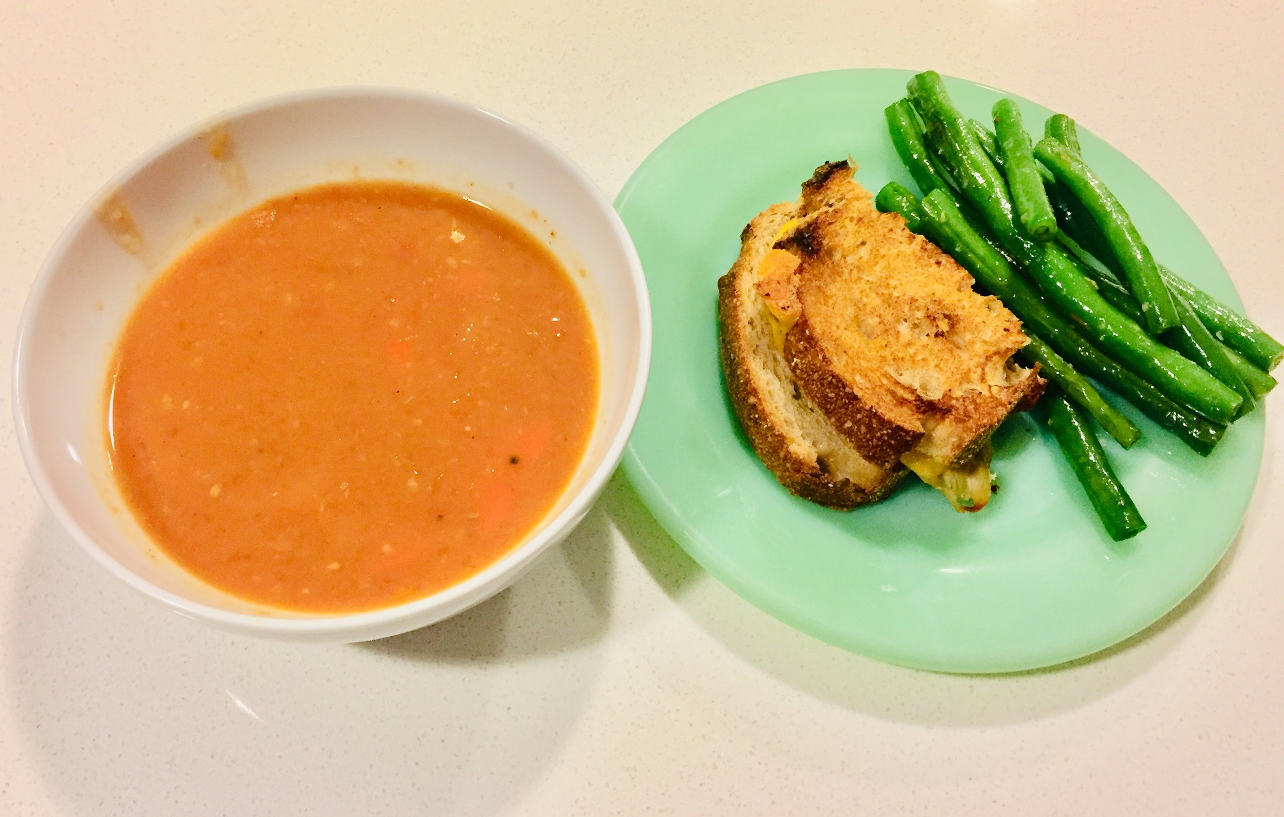 Home made tomato soup, grill cheese sandwich and green beans.