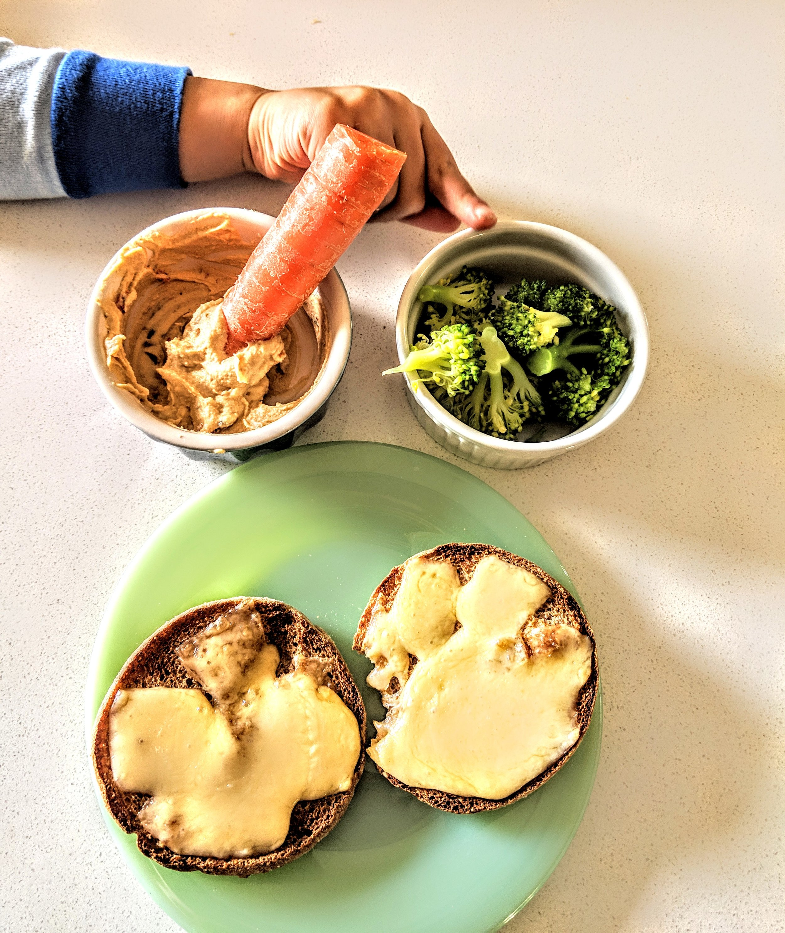 Hummus, carrot, broccoli, english muffin with cheese.