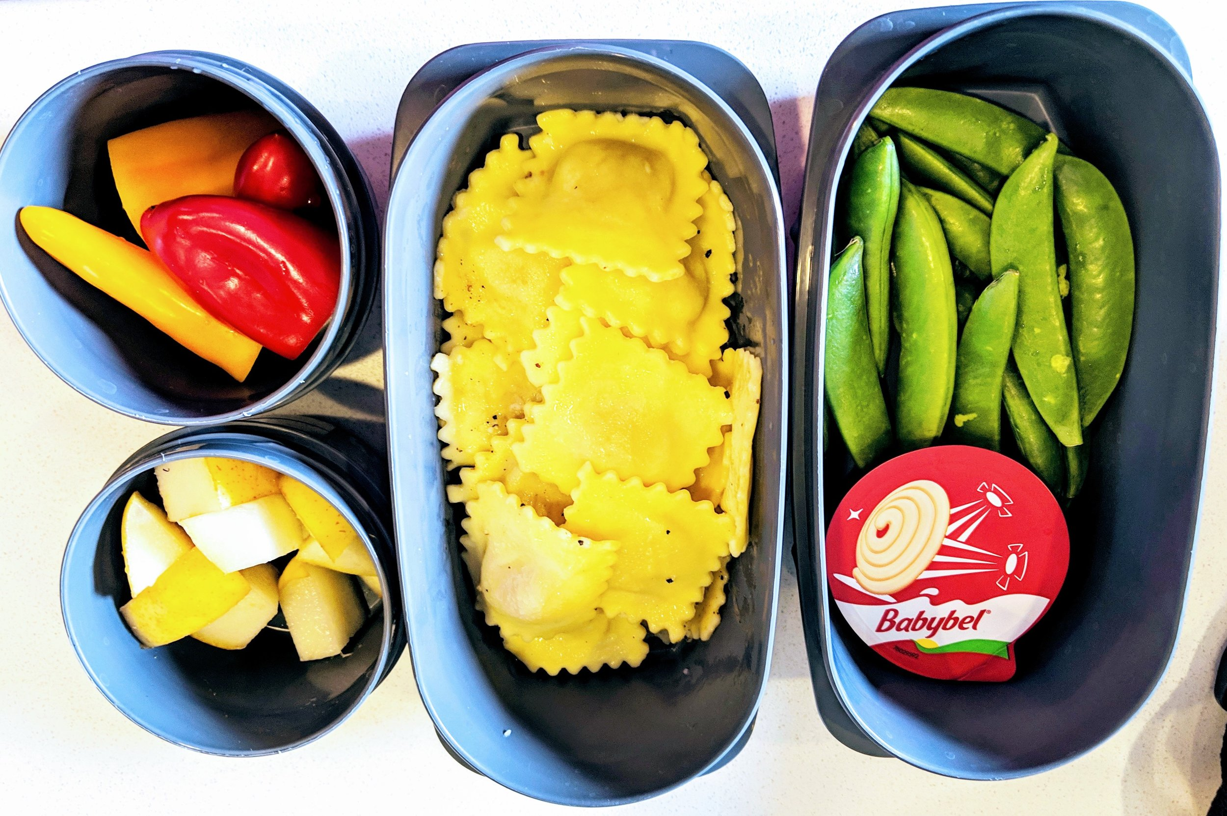 sweet mini peppers, pears, ravioli, sugar snap peas and cheese for Lunch.