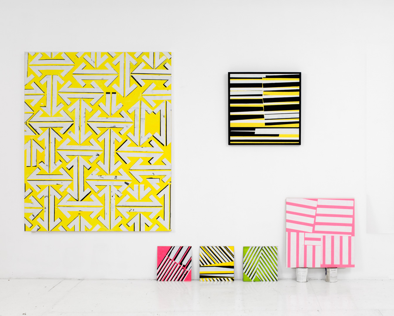 An installation shot showing works from the two series  Reign Marks  and  Company Paintings