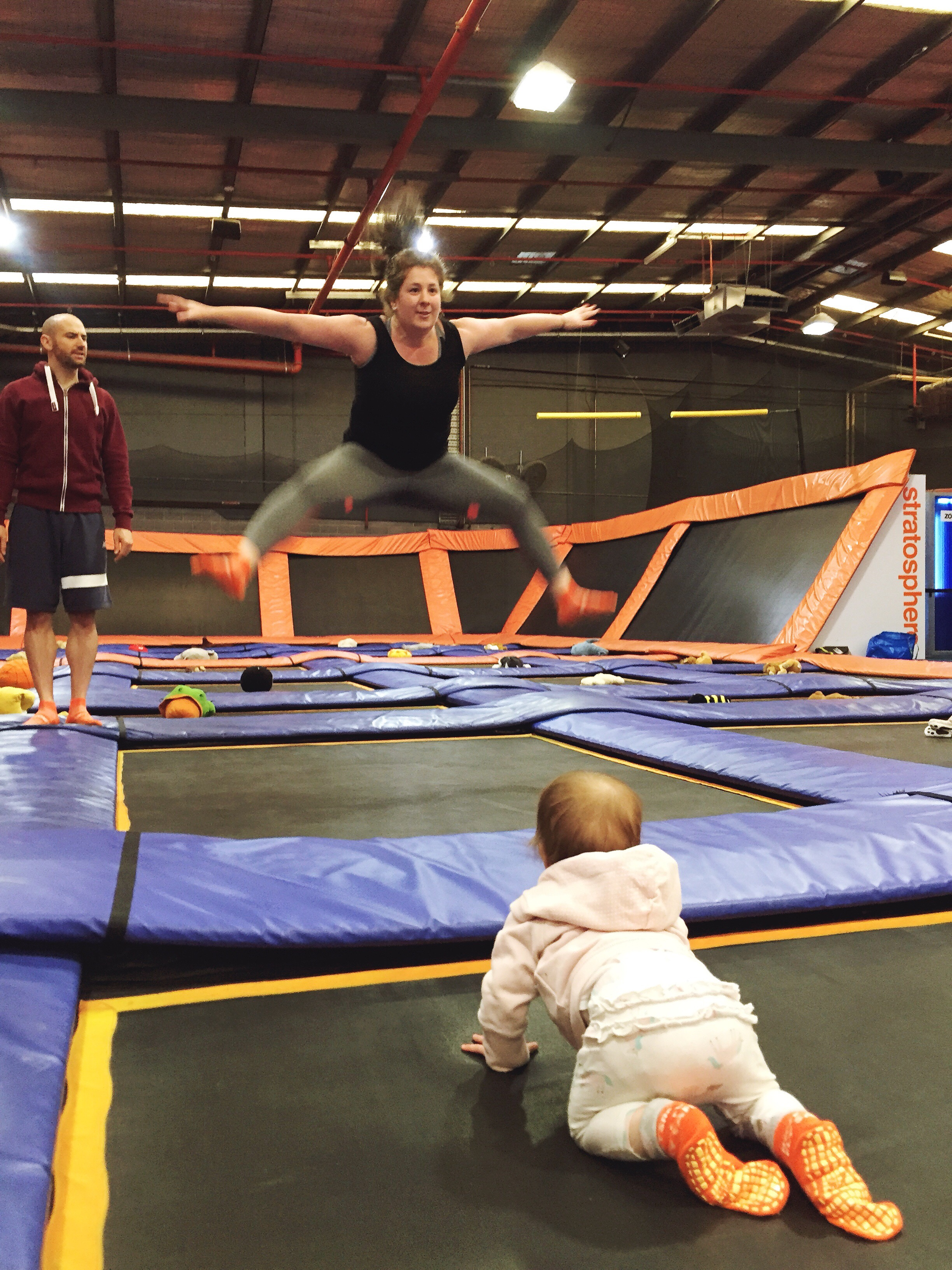 Mum and baby on trampoline