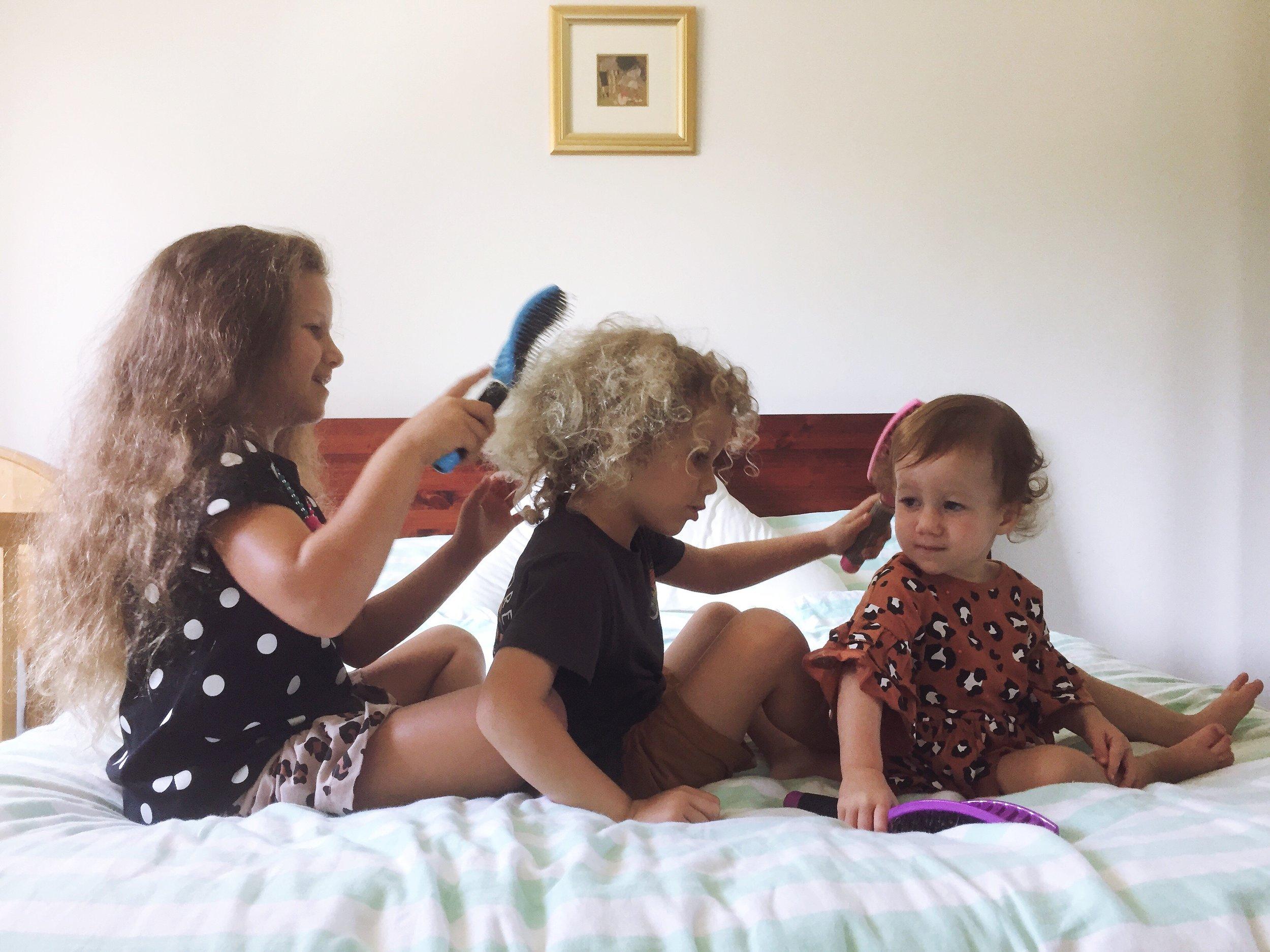 kids brushing hair