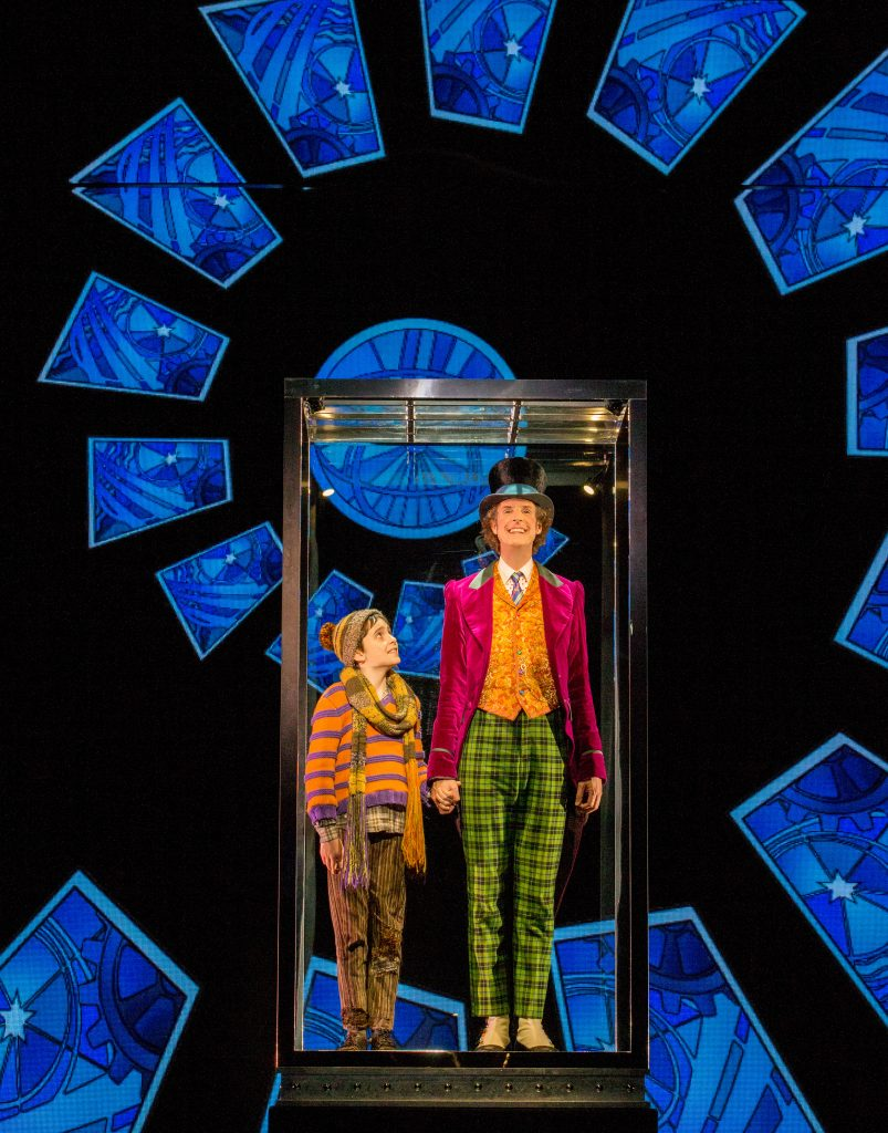 Ryan-Yeates-as-Charlie-and-Paul-Slade-Smith-as-Willy-Wonka-in-CHARLIE-AND-THE-CHOCOLATE-FACTORY-c-Jeff-Busby-803x1024.jpg