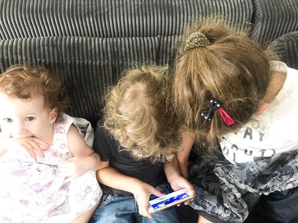 Children playing with iPhone