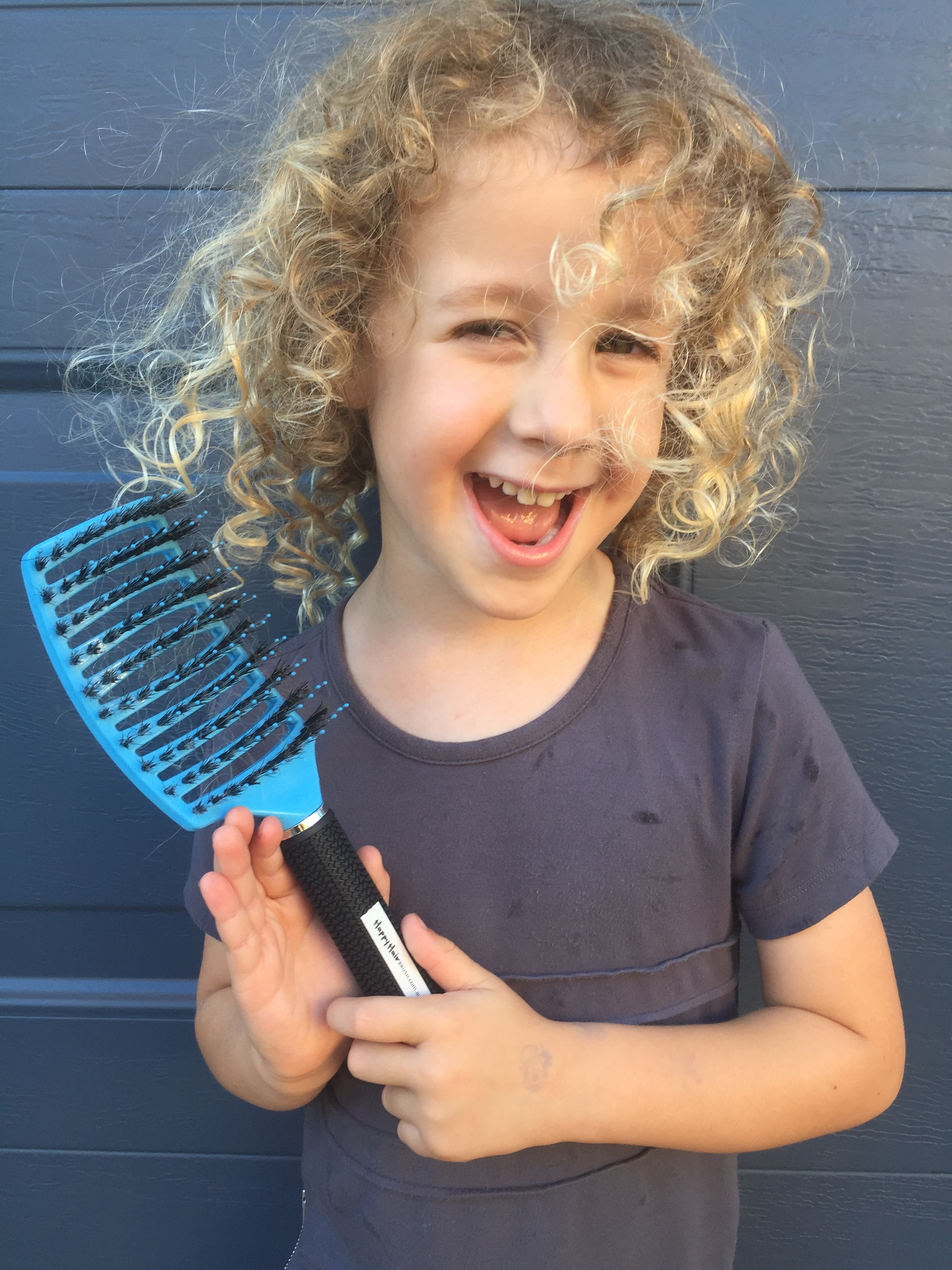 Boy and hairbrush