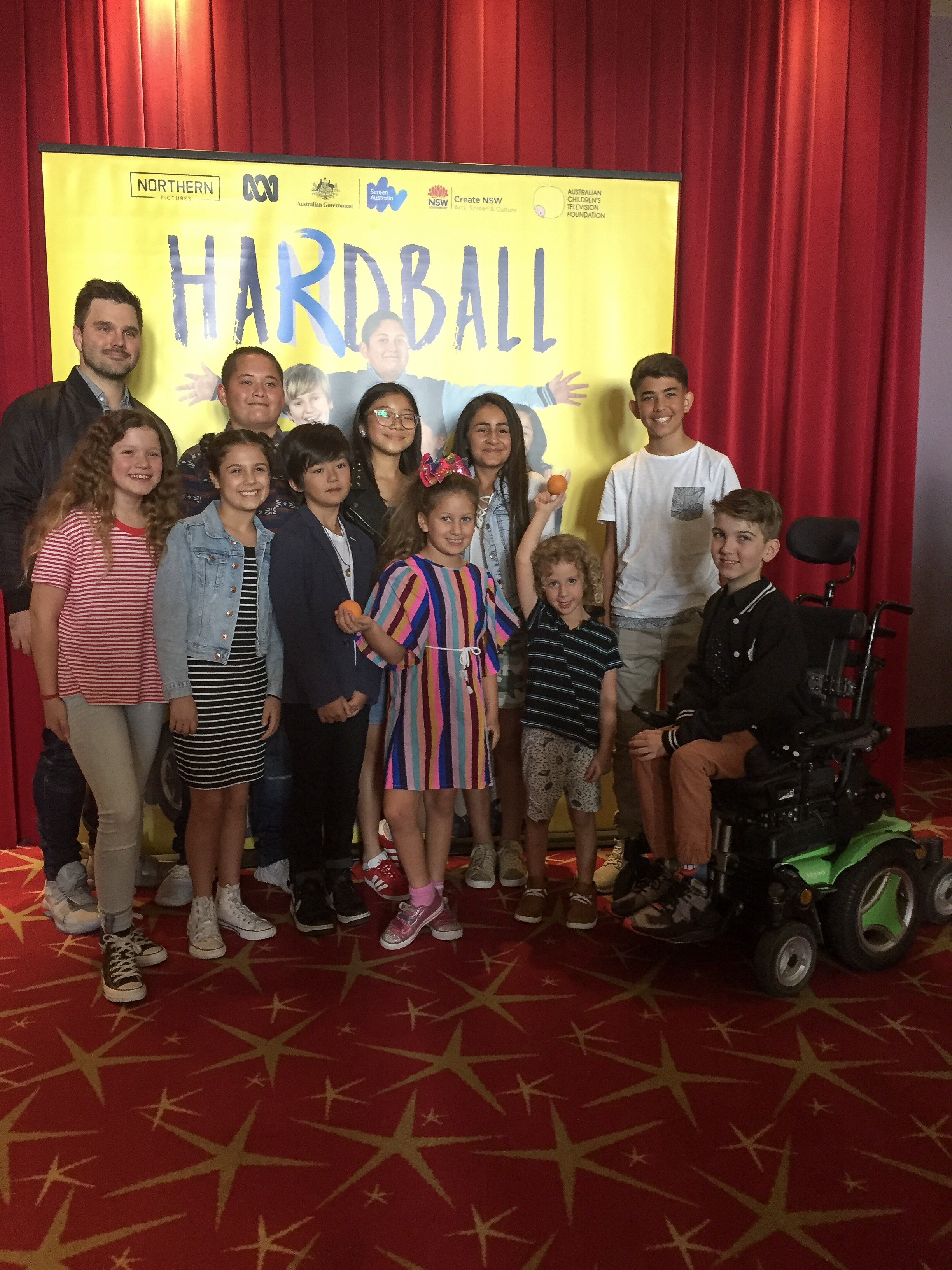 Denny and Noah posing with the cast of Hardball