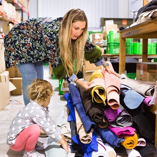 Jenny looking at fabric with her daughter