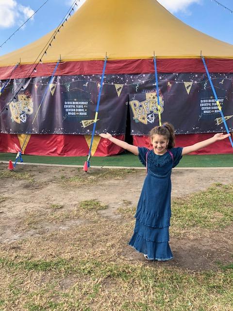 Girl outside tent