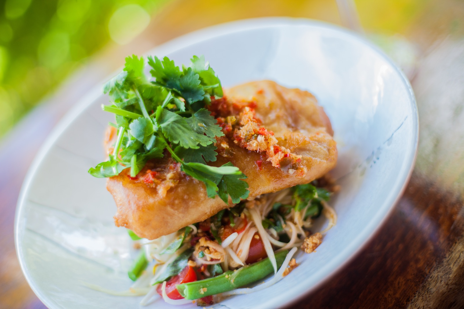 Coconut battered locally caught threadfin Salmon with smashed papaya salad $33.00 - Availability: Lunch & Dinner