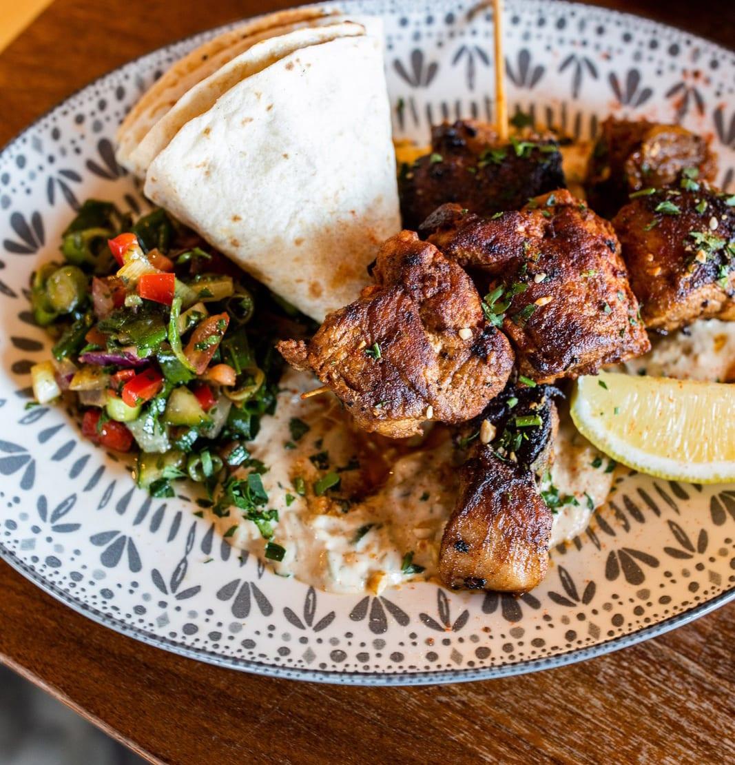Grilled free range Linley Valley 'Moorish' Pork fillet skewers, tahini yoghurt, mojo verde, tomato and parsley salad, fig jam, flatbread and lemon $27.00 - Availability: All day