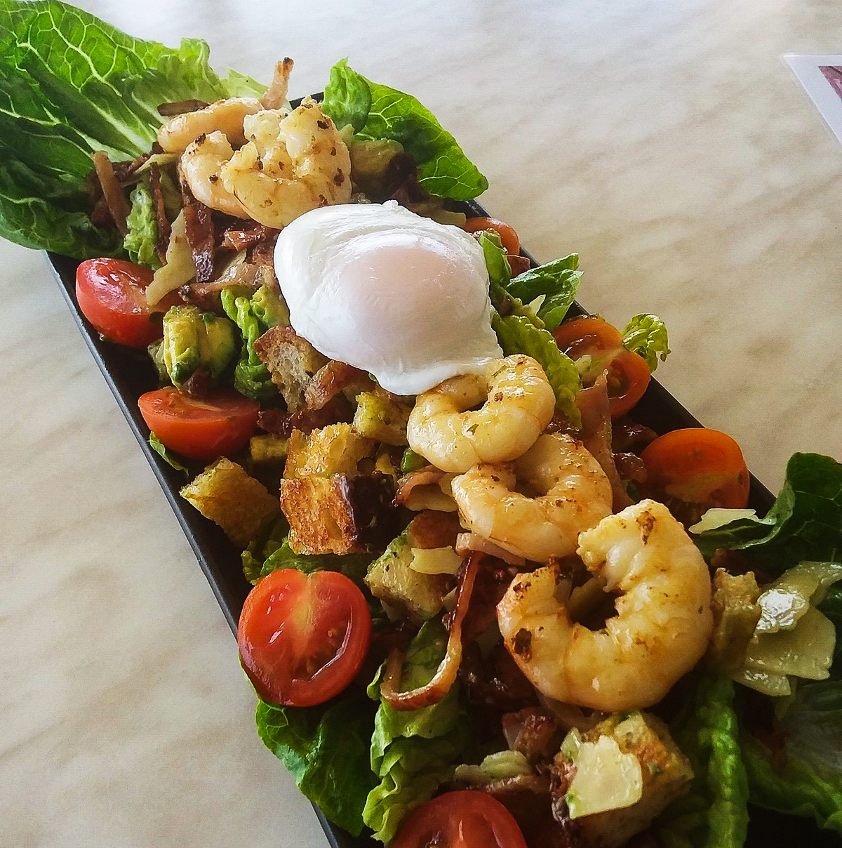 Sunsets King Prawn Caesar SaladCrisp Romaine lettuce, Carnarvon Avocados & Cherry Tomatoes, Crisp Bacon, Shaved Parmesan,Garlic Croutons tossed in a Caesar dressing topped with grilled Shark Bay King Prawns $26.00 - Availability: Lunch and Dinner, 11:30am – Closing times