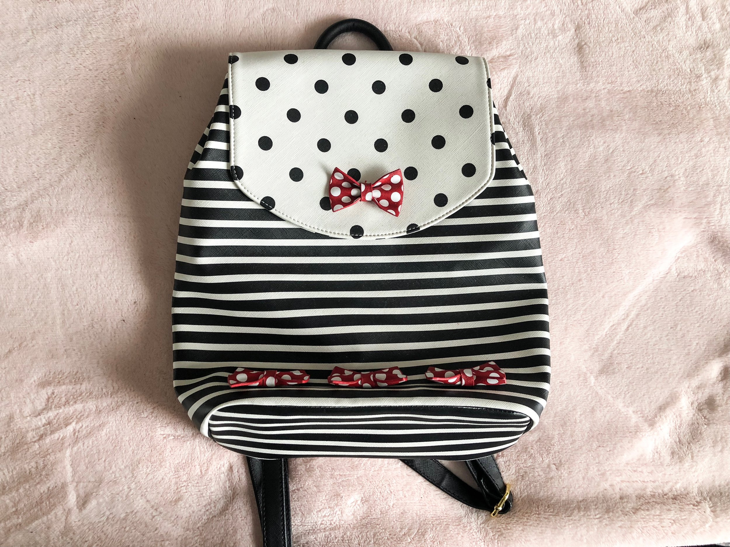 Minnie Backpack - If I'm in the parks for a long time, like a full day, I'll use this Minnie Mouse backpack from Disney instead of my purse - it just disperses weight better on my back and shoulders, and is easier to tote around for long periods of time.