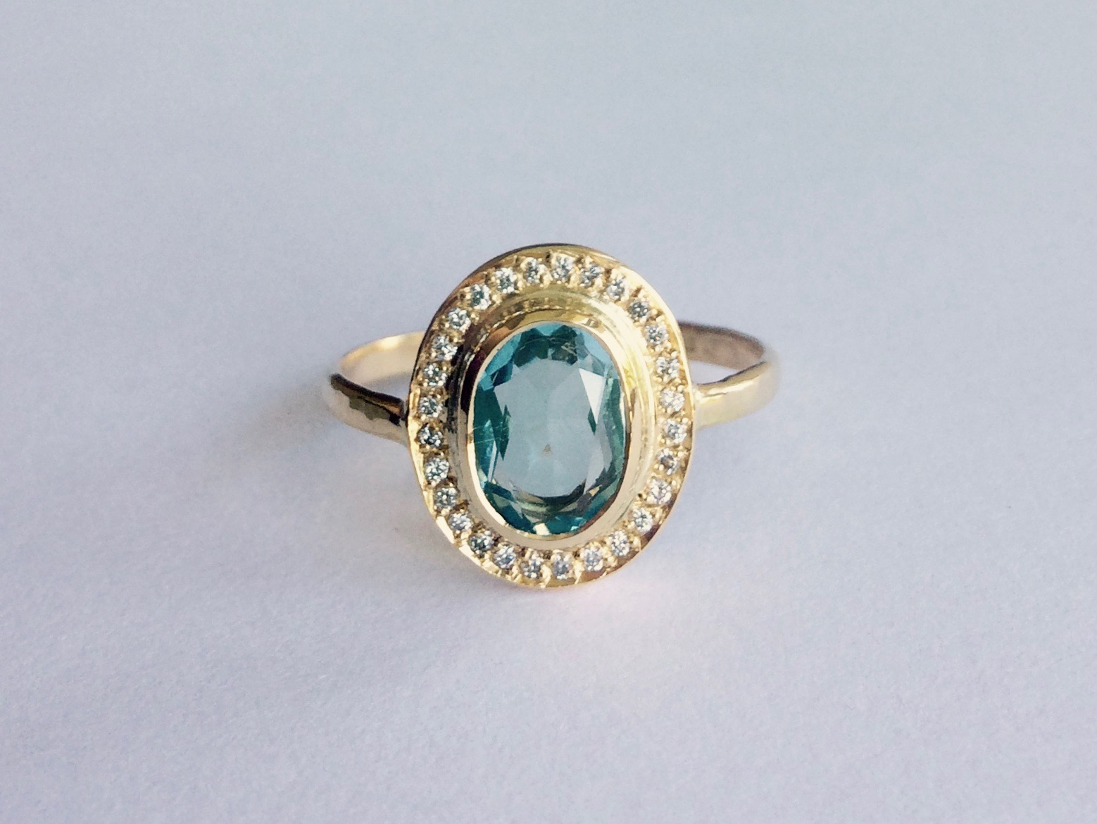 This humdinger of a ring was commissioned by gorgeous Nikki as a treat for herself and features a Topaz belonging to Nikki, set in Recycled 18ct yellow gold and Ethical Canadian Diamonds