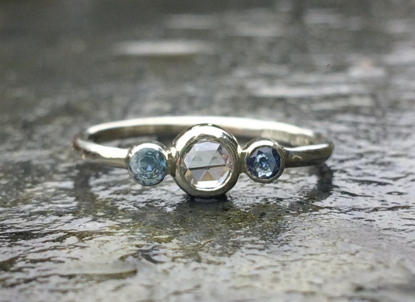 Dylan and Hannah's White Rose-cut Diamond Engagement Ring with Aquamarine and Sapphire. Ethical Gemstones set in 9ct Recycled White Gold.