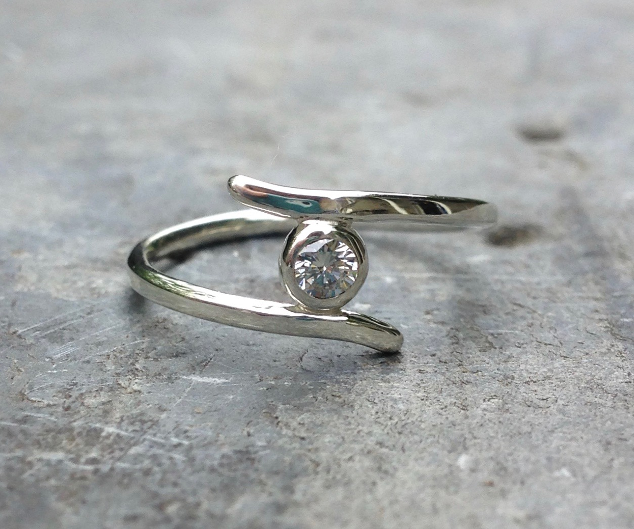Craig and Ellens's White  Canada Mark  Diamond set in Recycled 9ct White Gold