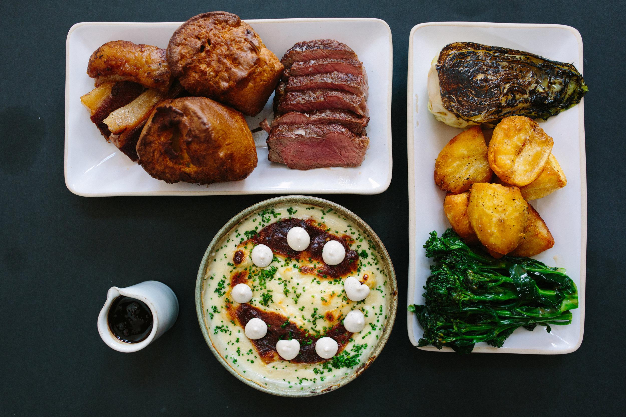 Sunday Roast - 60 day aged Sirloin and slow braised brisket for 2, roast potatoes, truffle cauliflower cheese, chargrilled hispi cabbage, roast carrots, Yorkshire puddings, beef gravy, smoked bone marrow and horseradish cream£25pp (minimum 2 people)