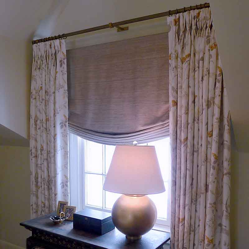 Draperies with relaxed roman shades - Silk blackout-lined relaxed roman shades and pleated linen draperies provide a contemporary look and darkness when you're ready to sleep.