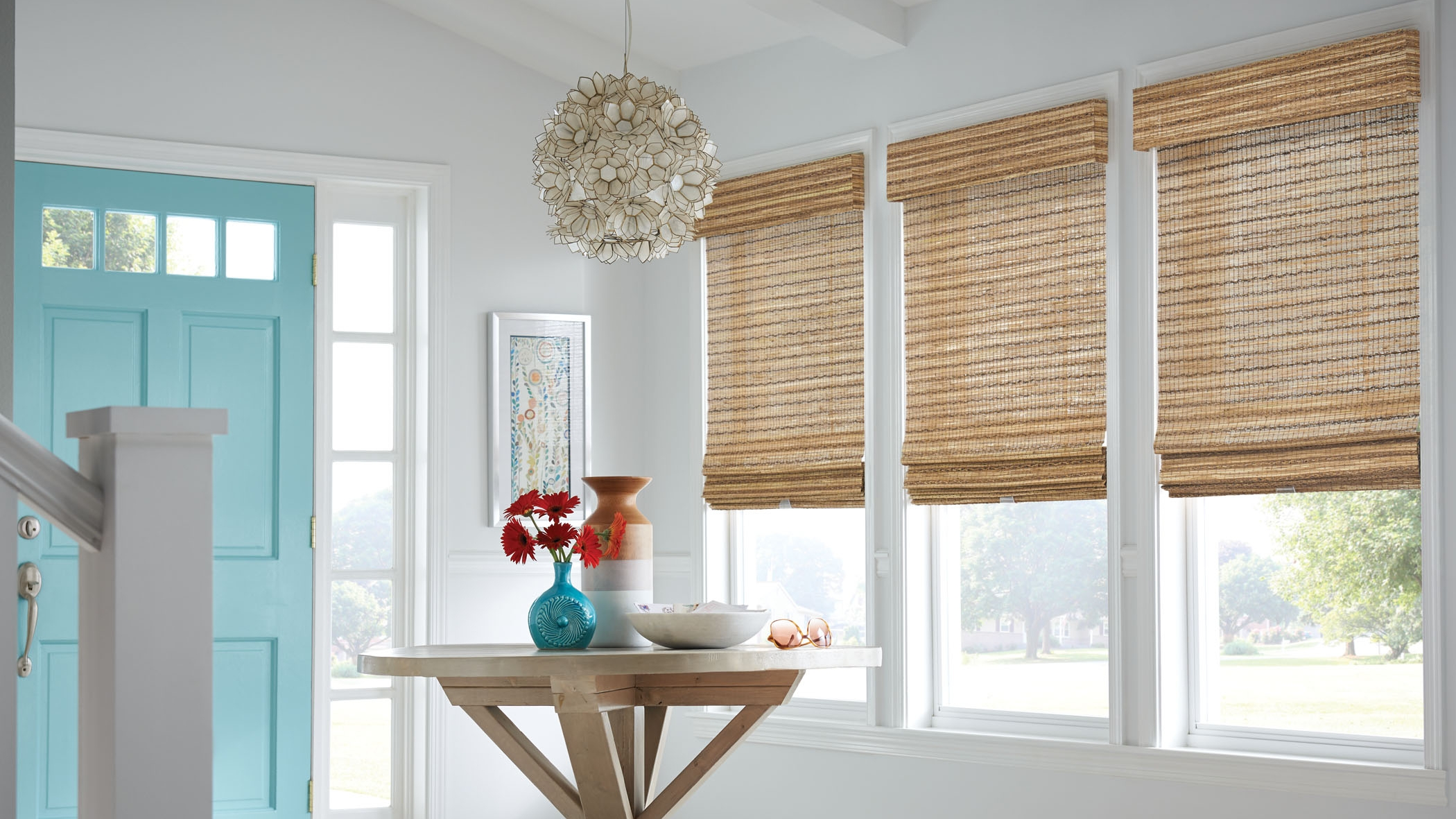Natural woven wood shades add privacy and a warm feeling to any room in your home. Photo courtesy of Graber.